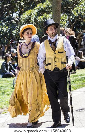 CAGLIARI, ITALY - May 29, 2016: Sunday at La Grande Jatte VIII Ed. At the Public Gardens - Sardinia - couple of young people parading in Victorian costumes