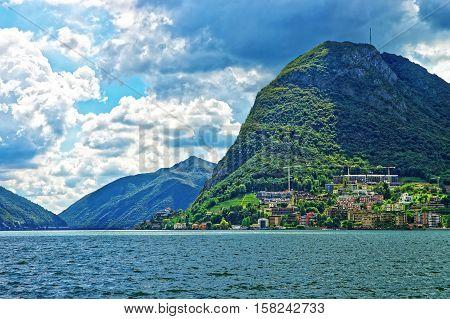 Houses At Lake Lugano And Mountains Ticino Of Switzerland