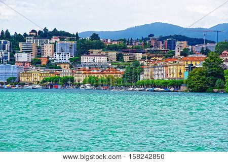 Houses At Lake Lugano And Mountains In Ticino Of Switzerland
