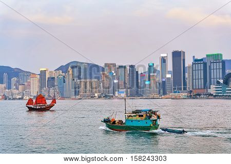 Junk Boat At Victoria Harbor Of Hk At Sundown