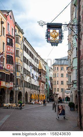 INNSBRUCK AUSTRIA - FEBRUARY 28, 2016: Old town restaurants and famous Golden Roof (Goldenes Dachl) in Innsbruck Tirol Austria