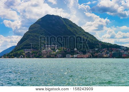 Lake Lugano And Alps Mountains In Ticino In Switzerland