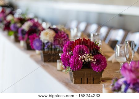 flower arrangements sitting on the wedding party table