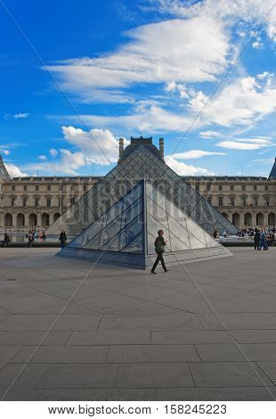 Louvre Pyramid And Louvre Palace In Paris