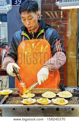 Male Trader Of Oysters In Myeongdong Open Street Market Seoul