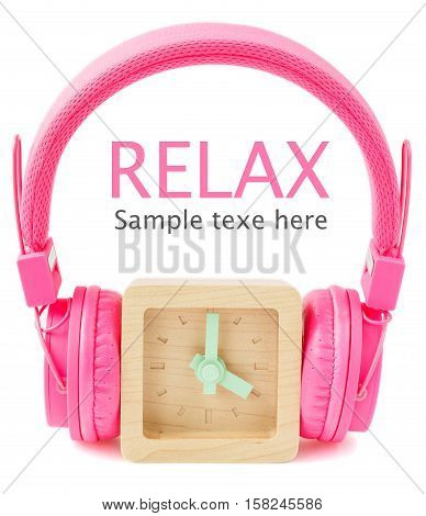 Concept relax - Wood clock with pink headphones on white background.