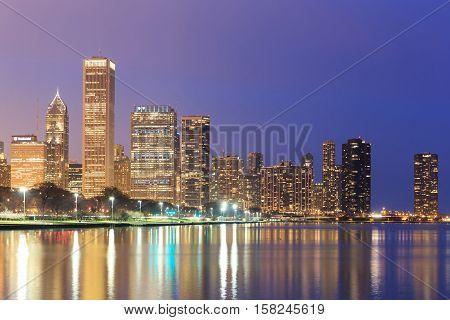 Downtown Chicago across Lake Michigan at sunset IL USA