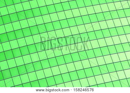 Abstract background of green glass building`s windows