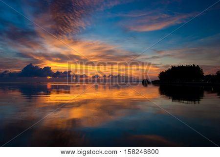 Orange and blue sunset on the beach.