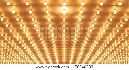 Old style theater marquee lights walkway to the theater. Aligned theater lights of Chicago Theater. Casino lights