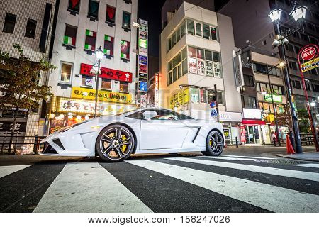 TOKYO, JAPAN - NOVEMBER 13, 2016: White Lamborghini Gallardo on the street of Ikebukuro district of Tokyo, Japan. Tokyo Metropolis is both the capital and most populous city of Japan.