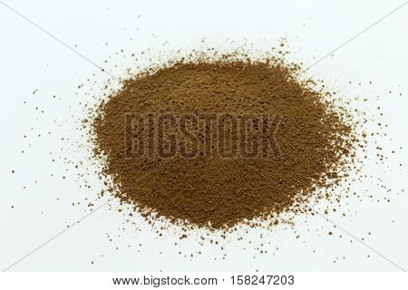 cocoa powder on a white background, crushed cocoa beans