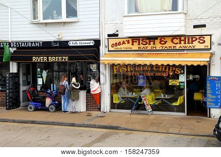 Littlehampton UK - October 25th 2016: Traditional fish and chip shops on the sea front selling both eat in and takeaway fish and chips