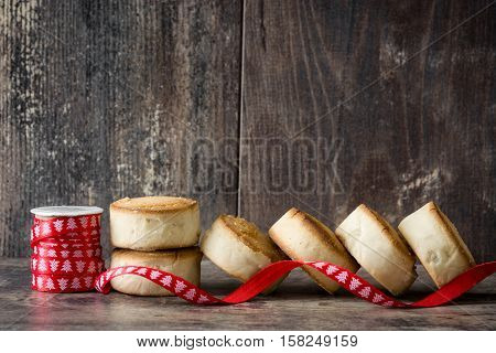 Traditional Christmas shortbread and christmas ornaments on wooden table