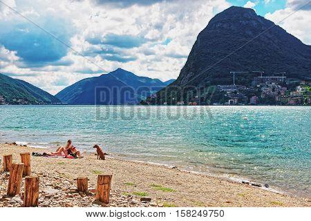 People On Beach In Lugano In Ticino In Switzerland