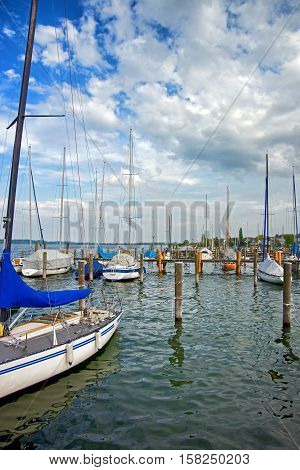 Pier With Boats In Reichenau Island And Lake Constance