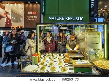 Seller And Buyers At Myeongdong Open Street Market In Seoul