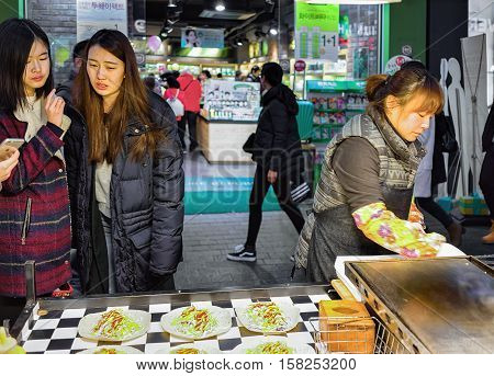Seller And Buyers In Myeongdong Street Market In Seoul