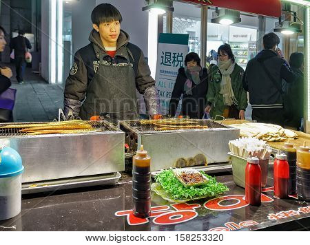 Seller Of At Myeongdong Open Street Market In Seoul