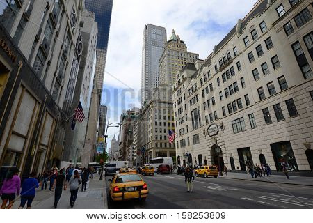 NEW YORK CITY - MAY 7, 2013: Fifth Avenue between 57th and 58th Street with the Crown Building and 712 Fifth Avenue Building at the background in midtown Manhattan, New York City, USA.