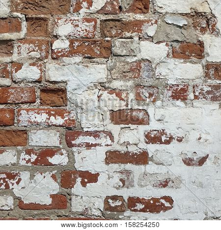 Abstract Red White Stonewall Urban Texture. Old Red Brick Wall With Shabby Damaged White Plaster. Painted Whitewashed Brickwall Grungy Background. Stonework Square Frame Grunge Empty Textured Background