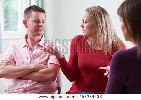 Couple Arguing In Front Of Relationship Counsellor