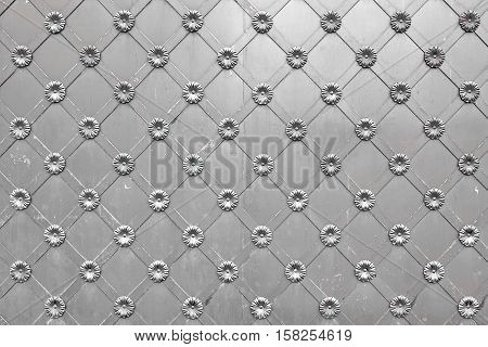 Old Silver Metal Gate Or Door With Iron Forged Decorative Grid Ornament Horizontal Background. Gray Castle Gate Vintage Aged Texture. Monastery Gate Grey Surface. Convent Or Abbey Door Structure
