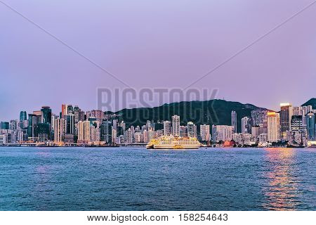 Skyline in Victoria Harbor of Hong Kong. View from Kowloon on HK Island.