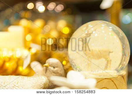 Christmas snow globe with an deer in snow inside of spere