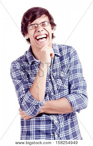 Young hispanic man wearing glasses and blue shirt with rolled up sleeves standing with hand on his chin and loudly laughing isolated on white background - laughter concept