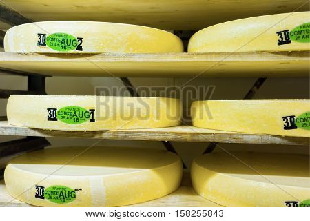 Stack Of Aging Cheese In Ripening Cellar Franche Comte Creamery