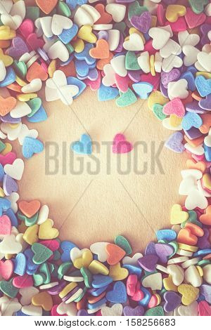 Heap of colorful candies confetti of heart shape blue and pink pair couple hearts romantic date copy space for text Valentine Day holiday concept