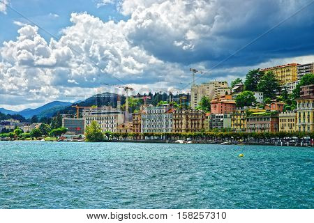 Swiss Houses At Lake Lugano And Mountains Of Ticino Switzerland