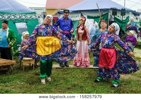 Tyumen, Russia - June 24, 2016: The 5th open championship of Russia on a plowed land. People in national costumes at center of Tatar culture