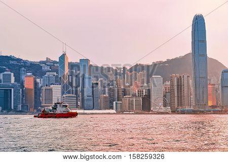 Water Boat At Victoria Harbor Of Hong Kong At Sunset