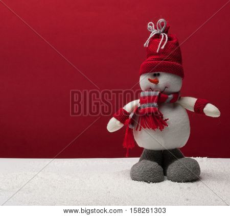 Snowman isolated on white background Snowman with red scarf and a cap