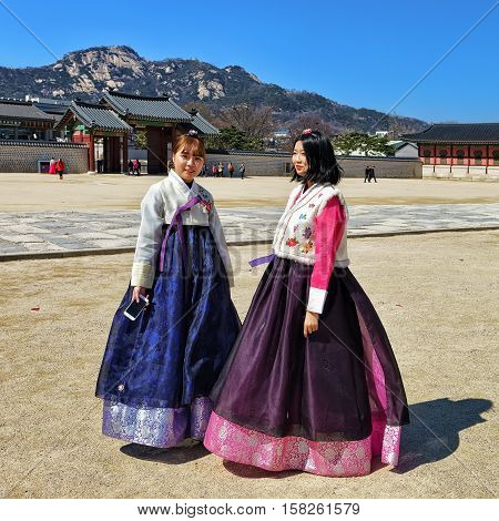Young Girls In Traditional Costumes At Gyeongbokgung Palace In Seoul