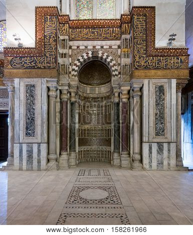 Cairo, Egypt - November 19, 2016: Interior view of ornate sculpted mihrab (niche) in front of the cenotaph in the mausoleum of Sultan Qalawun part of Sultan Qalawun Complex built in 1285 AD located in Al Moez Street Old Cairo Egypt