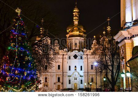 Holy Dormition Cathedral and Christmas Tree at night. Christmas in Kiev Pechersk Lavra Monastery