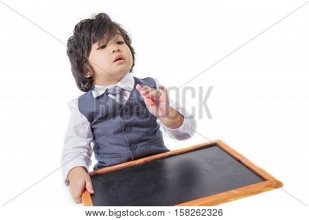 Boy in siut with blackboard on white board.