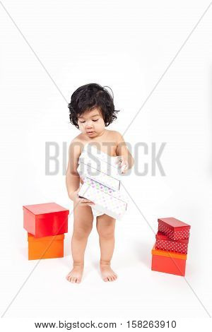 baby asian boy in diaper with boxes