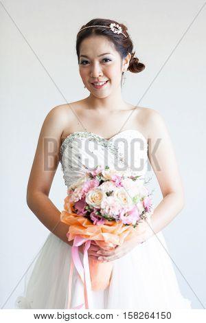 Happy beautiful bride up cloth white board