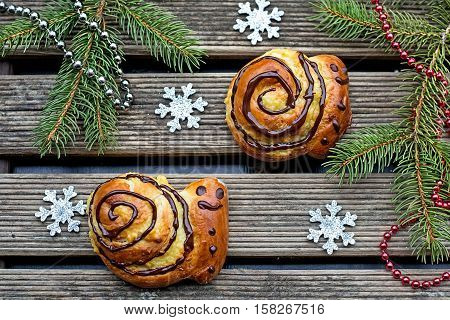 Buns brioche in shape of snail with custard and chocolate for Christmas