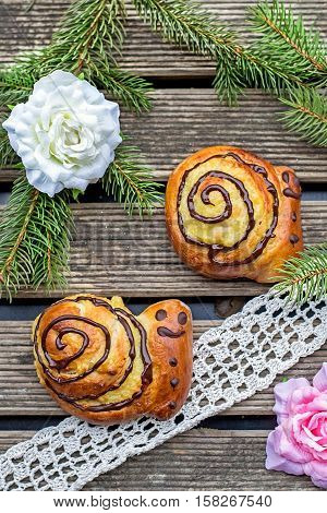 Buns brioche in shape of snail with custard and chocolate