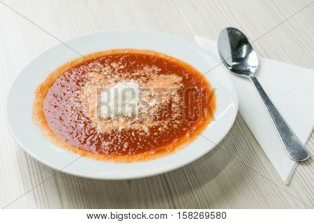 Tomato soup with shredded parmesan cheese on top