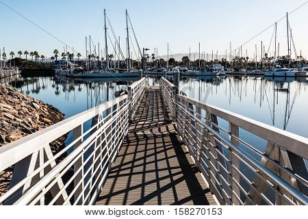 Chula Vista Bayfront park boat launch ramp with boats moored in marina.