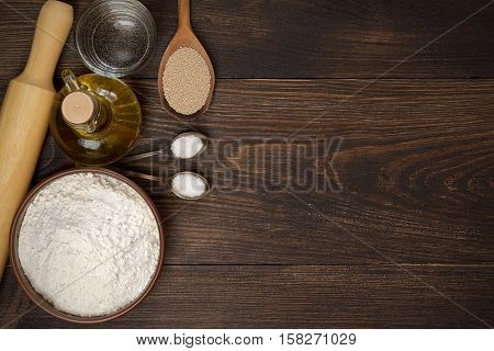Dark Rural Background With Ingredients For Pizza Dough.