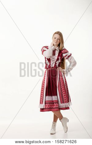 Young Beautiful Redhead Folk Dancer Woman With Gorgeous Long Hair In Traditional Authentic Folk Cost