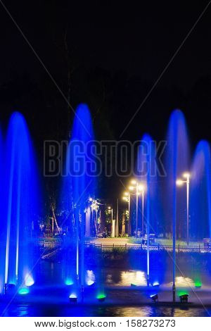 Fountain With Blue Backlight In Park