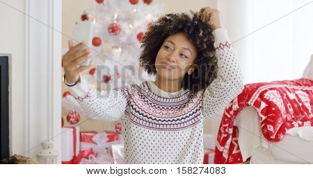 Young woman posing for a Christmas selfie